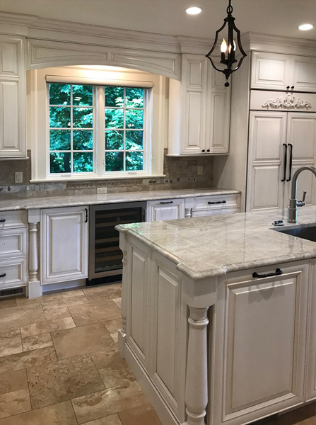 Transitional kitchen with white paint and raised panel doors