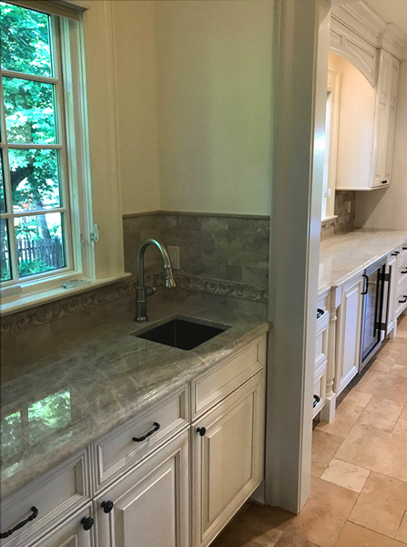Transitional kitchen with Taj Mahal granite countertops
