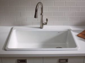 When choosing a sink for your kitchen remodel a top mount sink is easy to install but difficult to clean