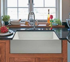 When choosing a sink for your kitchen remodel a farm house sink has an apron front with a vintage look