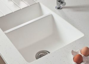 When choosing a sink for your kitchen remodel solid surface Corian is stain resistant