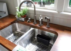 When choosing a sink for your kitchen remodel an undermount sink is installed under the counter