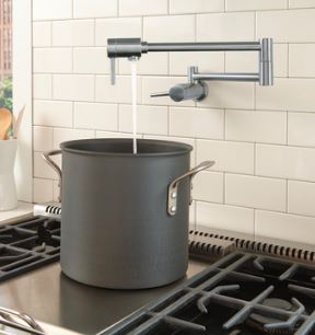 A pot filler saves steps for the chef in a gourmet kitchen