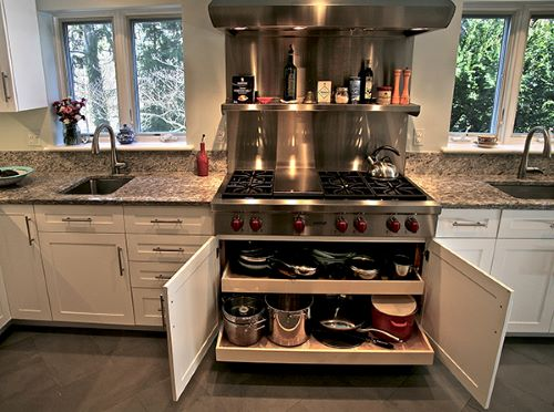 Roll out shelves under the cooktop for pots and pans storage is a kitchen remodeling choice you won't regret