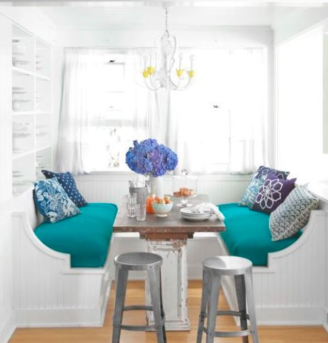 Kitchen seating using a banquette takes up less space than a table and chairs