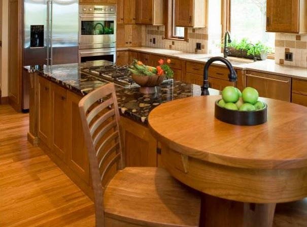 Kitchen island with integral table for casual eating