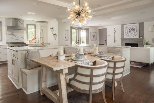 Seating in this open plan kitchen includes a bench seat on the back of the island