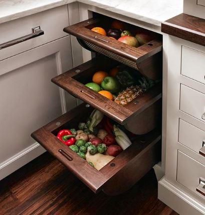 baskets on wood slides are a beautiful storage option