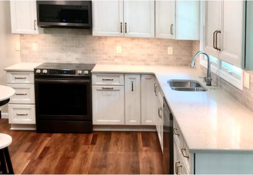 Beautiful new cabinets and floors in kitchen remodel