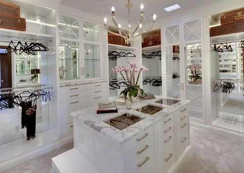 luxury walk-in closets with glass top island